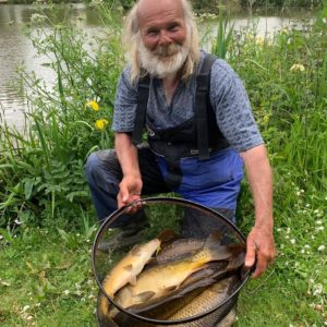 Old friend Ken cocks in action at Goodiford with a lovely net of carp!