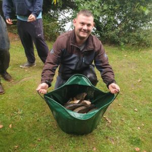 Luke Sefton a regular so simple customer from  Raker fishery with part of his winning net!