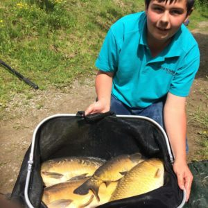 George Cox from Cheddar, with a Landsend net of carp, Thatchers junior champ last year,well done George!