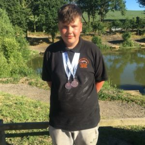 Young Mitchell Butterfield with his England medals!