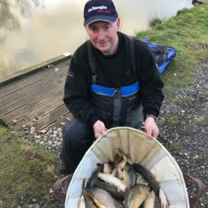 John Sanderson with a cracking winter net of small carp ,over our BMG and Boosted maggots!